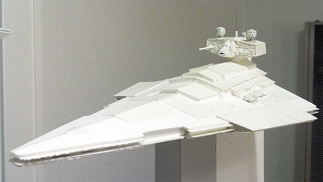 This wedge-shaped Star Wars ship has a massive superstructure and bridge tower (with two symmetrically-placed sensor globes) that are reminiscent of an aircraft carrier. Massive laser turrets flank either side of the superstructure. This view shows the model's current level of completion.